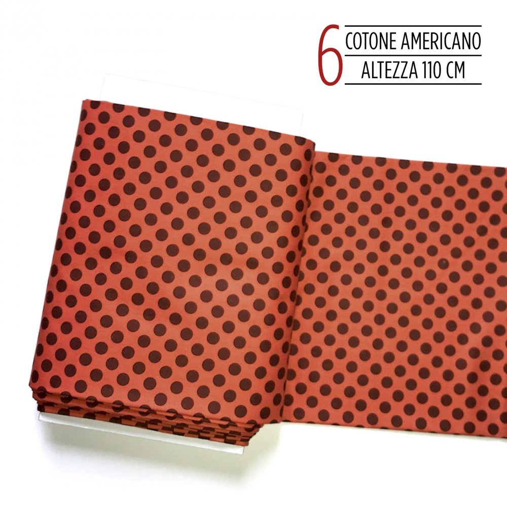 Tessuto americano incotone arancione con grossi pois marroni