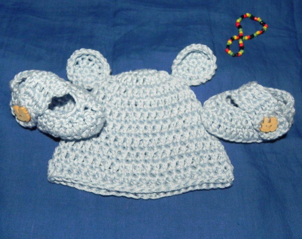 Cappellino e scarpette bebè in cotone azzurro