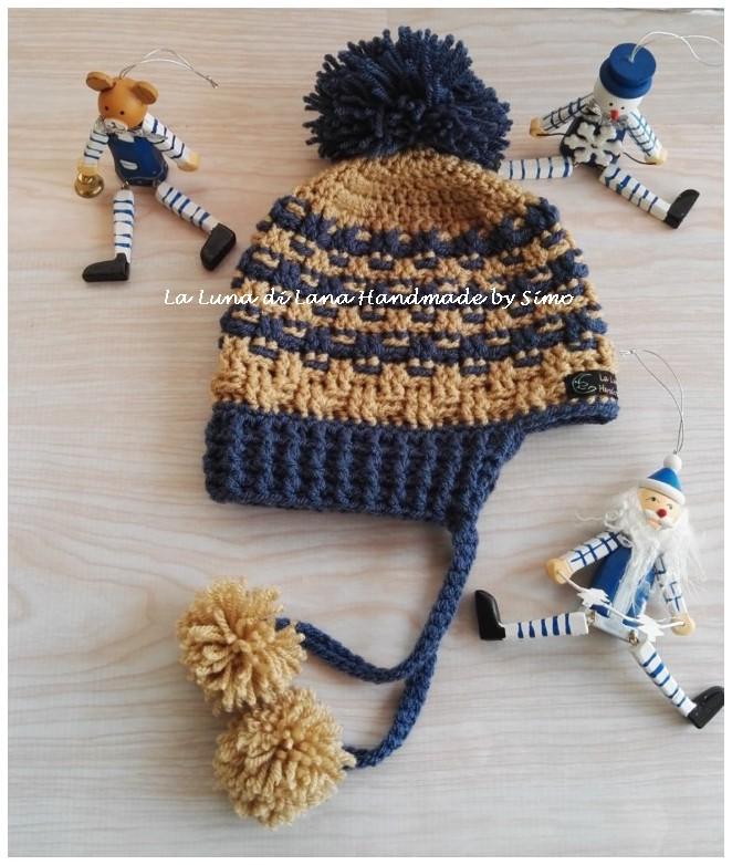 Cappellino per bambino o bambina ad uncinetto con pom pom e paraorecchi