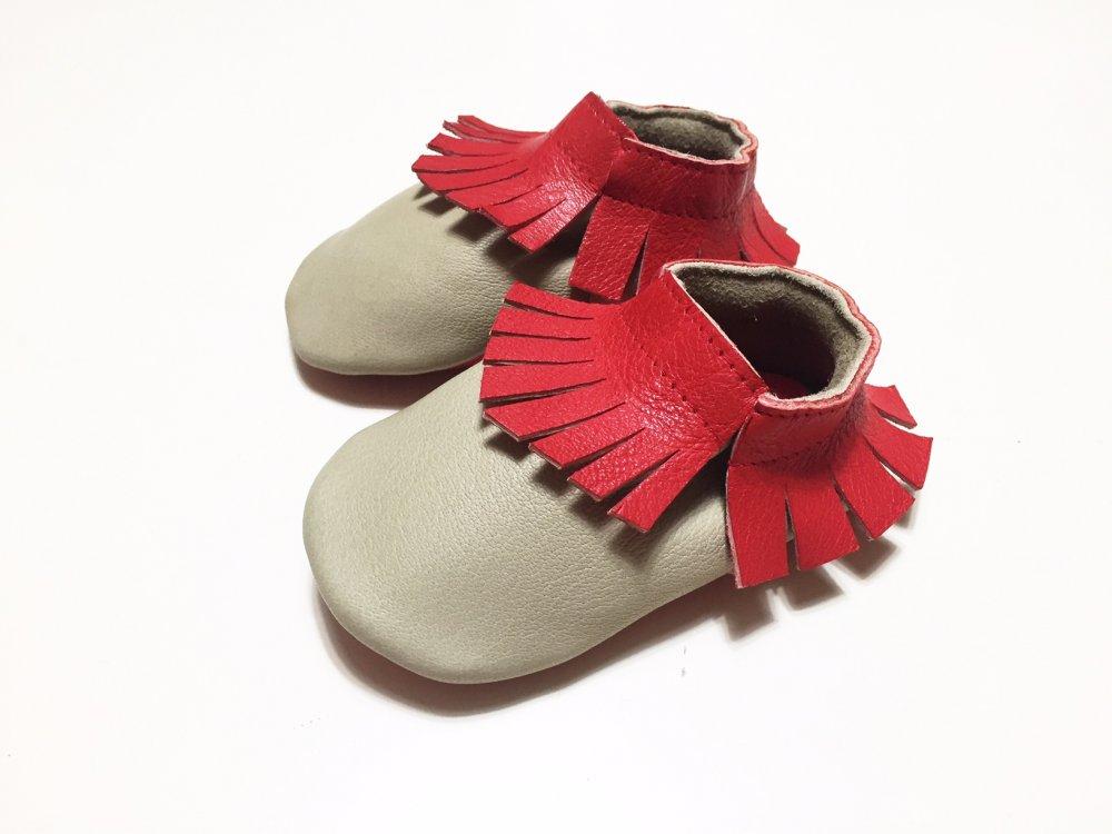 MOCASSINI IN VERA PELLE con frange per neonato e neonata