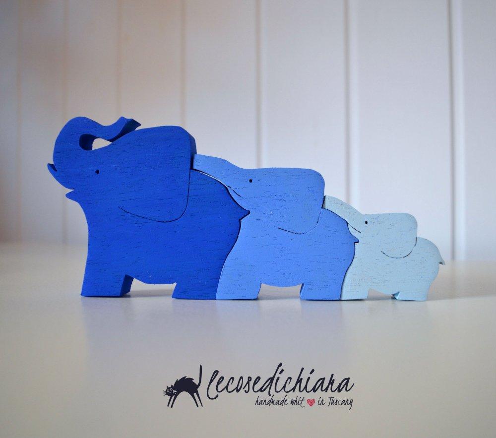Tris di Elefantini in legno dipinto