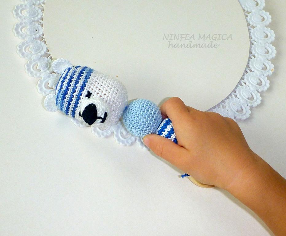 Il giocattolo sonalio con anello di legno di ginepro per la dentizione