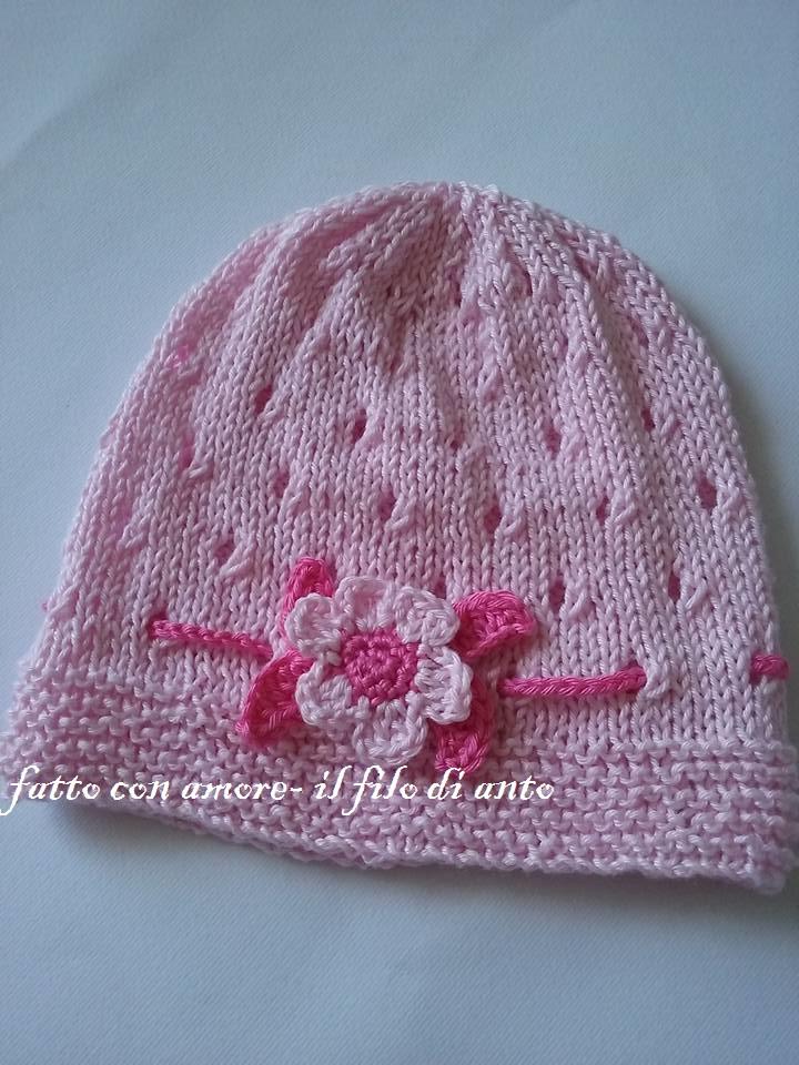 Cappello bambina rosa con fiore e foglioline