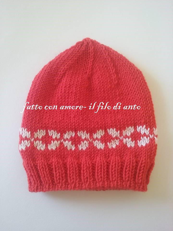 Cappello rosso con disegni jaquard in bianco in pura lana merinos