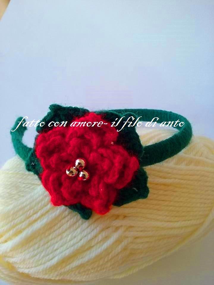 Cerchietto verde con fiore rosso