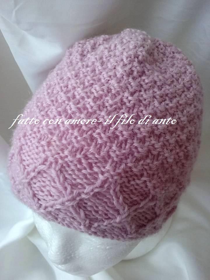 Cappello rosa in pura lana con lavoro a intrecci