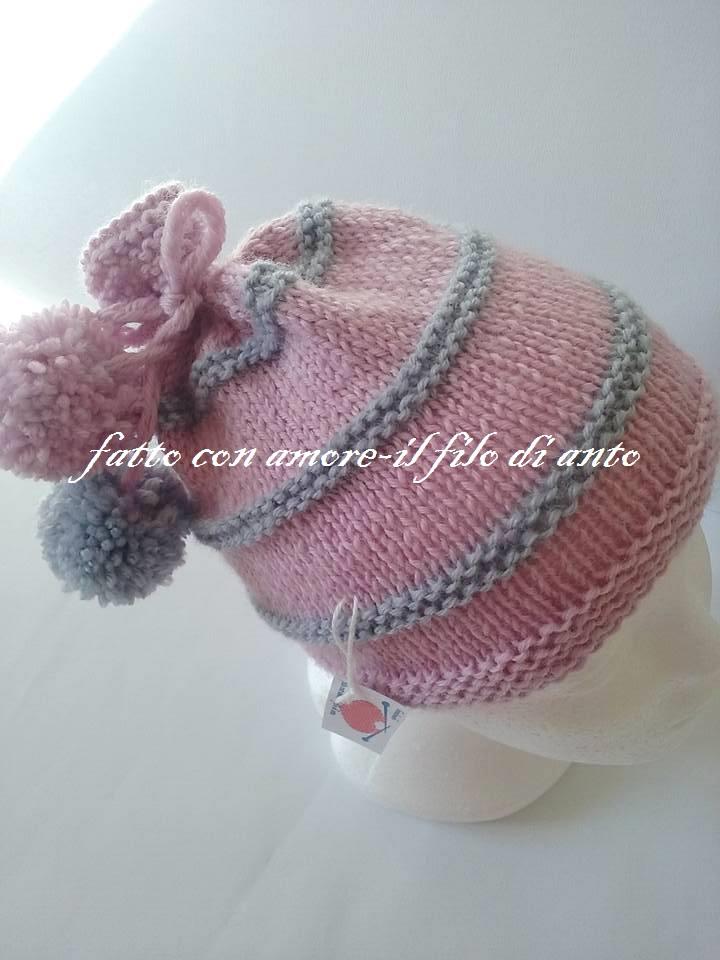 Cappello rosa e grigio in pura lana 100% con pom pom